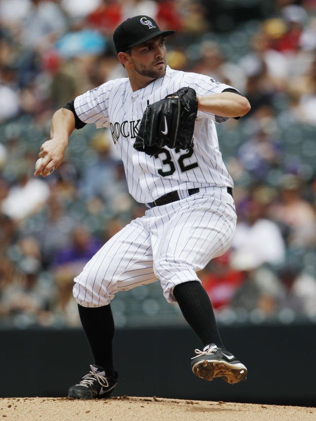 Colorado Rockies starting pitcher Tyler Chatwood works against the Philadelphia Phillies in the first inning of a baseball game in Denver, Saturday, June 15, 2013. (AP Photo/David Zalubowski)