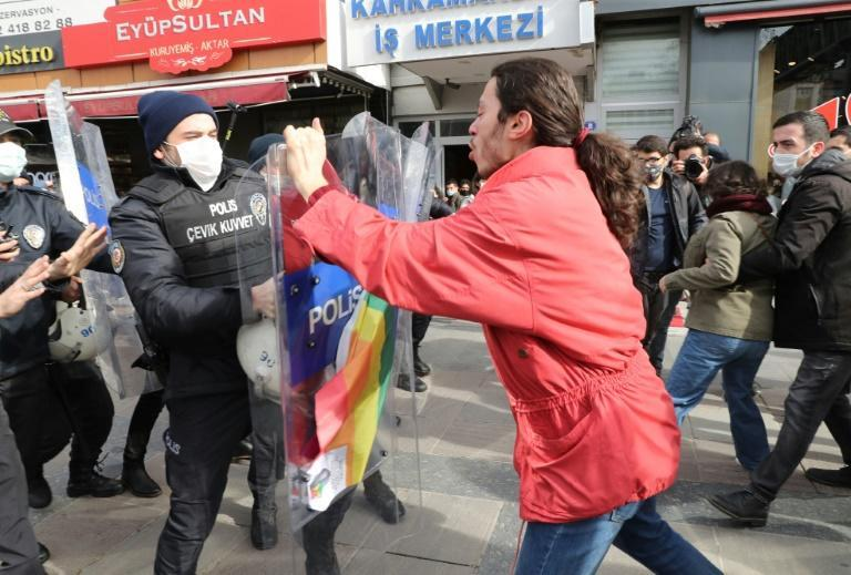 A man clashes with Turkish Police detaining activists in Ankara