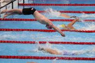 Britain's Duncan Scott dives in for the final leg of the men's 4x200-meter relay at the 2020 Summer Olympics, Wednesday, July 28, 2021, in Tokyo, Japan. (AP Photo/Charlie Riedel)