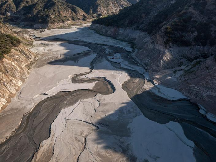 The drought turned the San Gabriel reservoir lake bed to dust