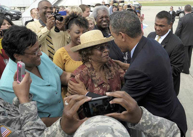 President Barack Obama greets people after arriving at San Antonio International Airport in San Antonio, Texas, Tuesday, July 17, 2012. Obama is spending the day fundraising in Texas. (AP Photo/Susan Walsh)