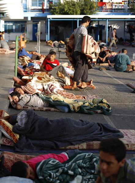 Displaced Palestinians sleep at a United Nations (UN) school in Beit Lahia in the northern Gaza Strip on August 4, 2014