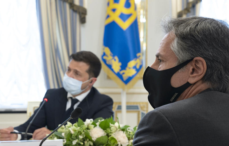 In this photo released by the Ukrainian Presidential Press Office, Ukrainian President Volodymyr Zelenskyy, left, and U.S. Secretary of State Antony Blinken, right, attend the during their meeting talks in Kyiv, Ukraine, Thursday, May 6, 2021. Secretary of State Antony Blinken has met with top Ukrainian officials in Kyiv and reaffirmed Washington's support for the country in the wake of heightened tensions with Russia, fueled by its recent troop buildup. (Ukrainian Presidential Press Office via AP)