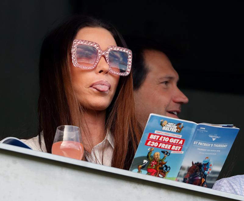 CHELTENHAM, UNITED KINGDOM - MARCH 15: (EMBARGOED FOR PUBLICATION IN UK NEWSPAPERS UNTIL 24 HOURS AFTER CREATE DATE AND TIME) Katie Price watches the racing as she attends day 3 'St Patrick's Thursday' of the Cheltenham Festival at Cheltenham Racecourse on March 15, 2018 in Cheltenham, England. (Photo by Max Mumby/Indigo/Getty Images)