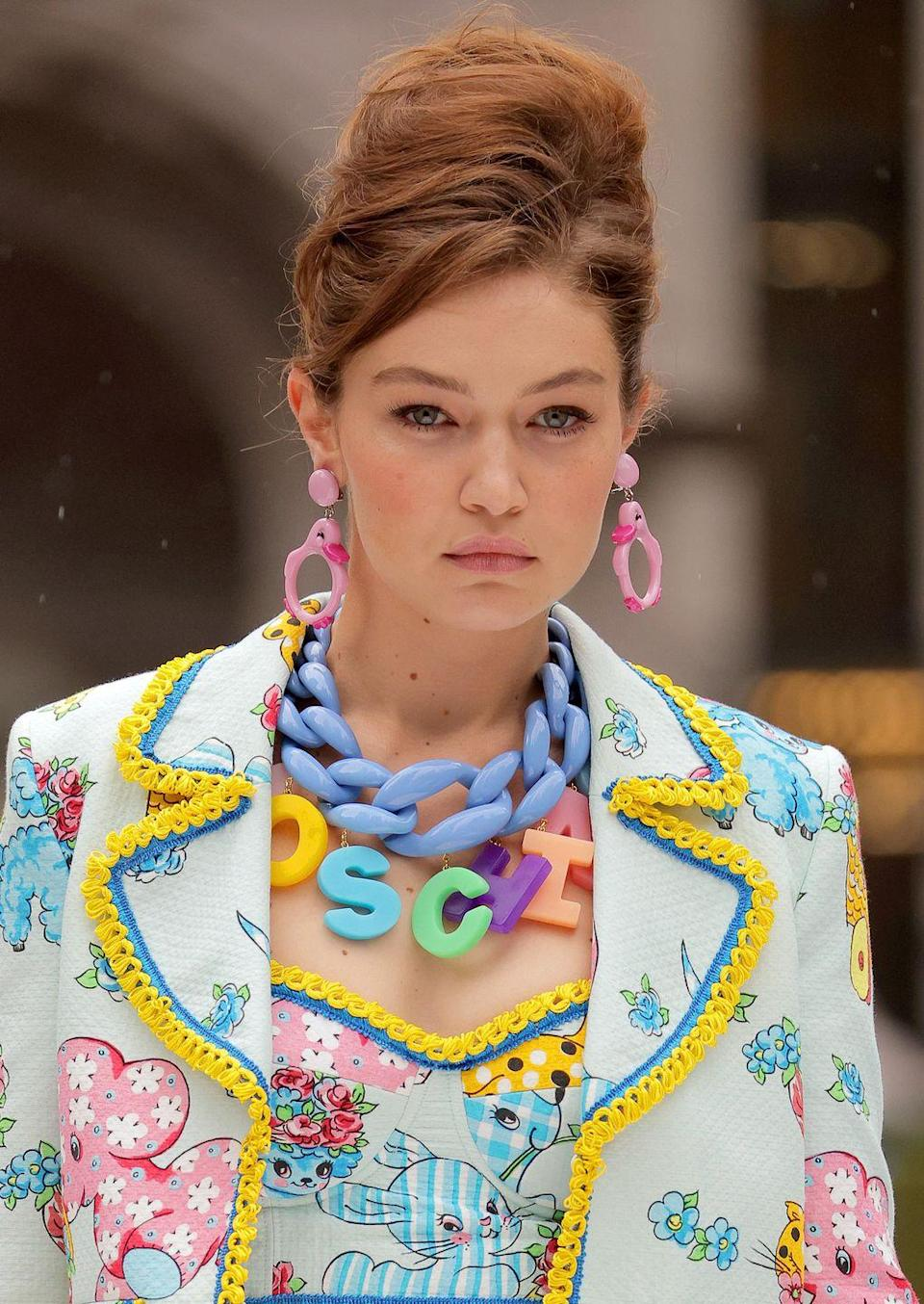 <p>Bigger is most definitely better in the case of this jewelry trend. </p><p><em>Moschino</em></p>
