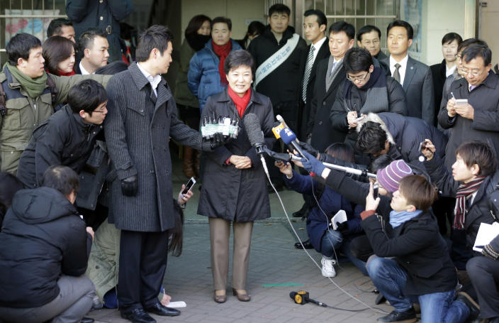 South Korea's presidential candidate Park Geun-hye, center, of the ruling Saenuri Party speaks to the media after she cast her ballot for presidential election at a polling station in Seoul, South Korea, Wednesday, Dec. 19, 2012. South Koreans bundled in thick mufflers and parkas braved frigid weather Wednesday to choose between the liberal son of North Korean refugees and the conservative daughter of a late dictator. For all their differences, the presidential candidates hold similar views on the need to engage with Pyongyang and other issues. (AP Photo/Lee Jin-man)