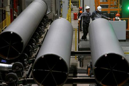 FILE PHOTO: Men are seen at work at Zagorsk Pipe Plant (ZTZ), which launched the production of large-diameter pipes for Russian gas giant Gazprom, outside Moscow, Russia May 29, 2017. REUTERS/Sergei Karpukhin/File Photo