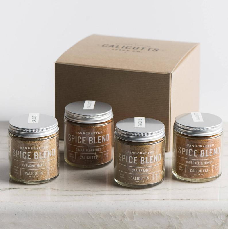 """<h2>4 Jars Of Handcrafted Spice Blends</h2><br>Each tasty, natural blend is crafted from a small batch of sourced ground spices in their shop near Harrisburg, Pennsylvania.<br><br><strong><em><a href=""""https://www.etsy.com/shop/CalicuttsSpiceCo?ref=simple-shop-header-name&listing_id=256314758"""" rel=""""nofollow noopener"""" target=""""_blank"""" data-ylk=""""slk:Shop Etsy"""" class=""""link rapid-noclick-resp"""">Shop Etsy</a></em></strong><br><br><strong>CalicuttsSpiceCo</strong> 4 Jars of Handcrafted Spice Blends, $, available at <a href=""""https://go.skimresources.com/?id=30283X879131&url=https%3A%2F%2Fwww.etsy.com%2Flisting%2F256314758%2Fthe-grill-master-gift-box-4-jars-of"""" rel=""""nofollow noopener"""" target=""""_blank"""" data-ylk=""""slk:Etsy"""" class=""""link rapid-noclick-resp"""">Etsy</a>"""