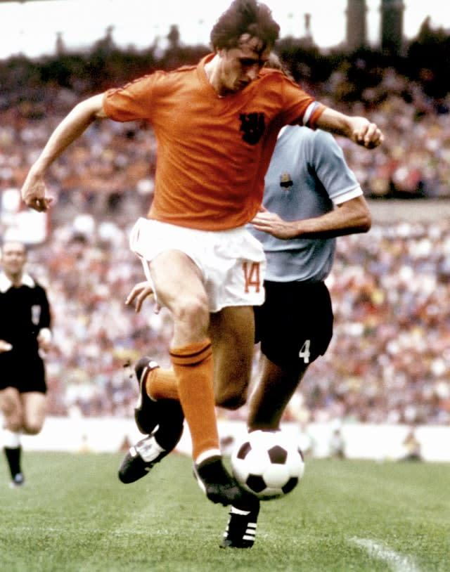 Johan Cruyff in action for Holland at the 1974 World Cup finals (PA)