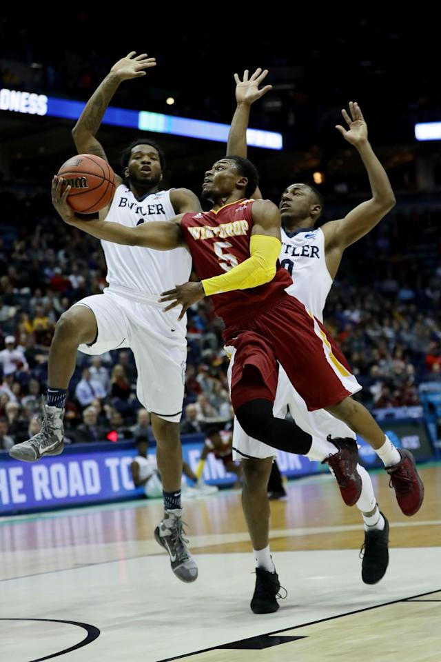 <p>Keon Johnson #5 of the Winthrop Eagles attempts a shot past Tyler Wideman #4 and Avery Woodson #0 of the Butler Bulldogs in the first half during the first round of the 2017 NCAA Men's Basketball Tournament at BMO Harris Bradley Center on March 16, 2017 in Milwaukee, Wisconsin. (Photo by Jonathan Daniel/Getty Images) </p>