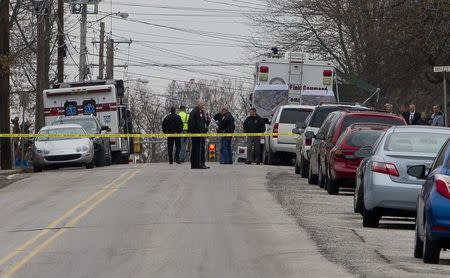 Police has the streets taped off as the search near a home in a suburb of Philadelphia where a suspect in five killings was believed to be barricaded in Souderton, Pennsylvania, December 15, 2014. REUTERS/Brad Larrison