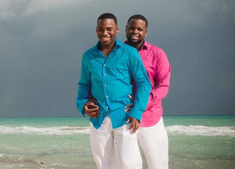 This Sunday, Dec. 1 2013 photo provided by the couple shows Jeremiah Pyant, left, and Jeff Robertson during their proposal ceremony in Cancun, Mexico. Winning a contest held by the American Civil Liberties Union, they and four other couples will get logistical and financial help from the ACLU to get married the week of April 28, 2014 in one of the 17 states, plus Washington D.C., which do allow gay marriage. They hope to marry aboard a hot air balloon taking off from Texas, where same-sex marriage is banned, and fly over the border into New Mexico, where it is legal. (AP Photo/Mexican Wedding Photography, Mikel Razo)