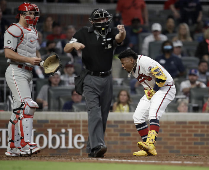 Atlanta Braves' Ronald Acuna Jr., right, reacts after being hit by a pitch thrown by Philadelphia Phillies' Sam Coonrod (not shown) in the seventh inning of a baseball game Saturday, May 8, 2021, in Atlanta. (AP Photo/Ben Margot)