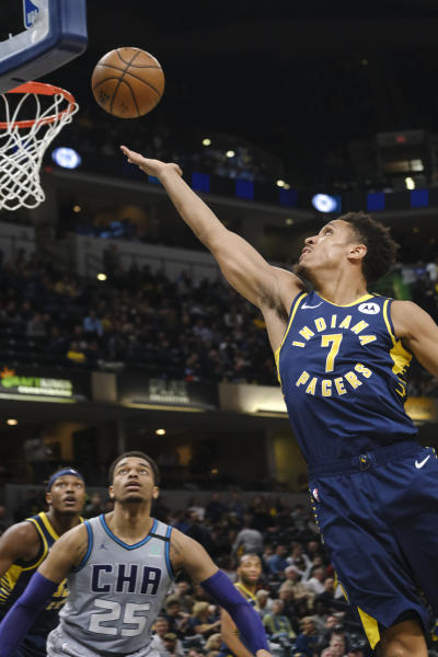 Indiana Pacers guard Malcolm Brogdon (7) shoots in front of Charlotte Hornets forward PJ Washington (25) during the second half of an NBA basketball game in Indianapolis, Tuesday, Feb. 25, 2020. (AP Photo/AJ Mast)