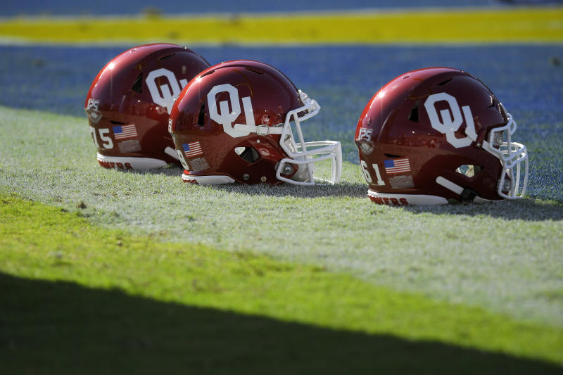 Oklahoma helmets sit on the field prior to an NCAA college football game against UCLA Saturday, Sept. 14, 2019, in Pasadena, Calif. (AP Photo/Mark J. Terrill)