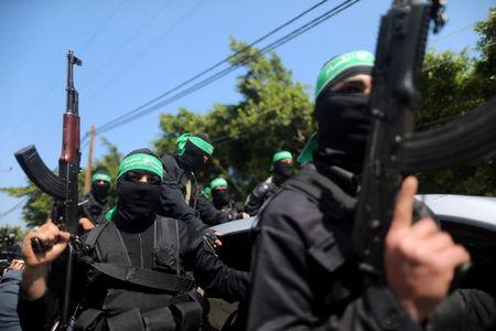 FILE PHOTO - Palestinian members of Hamas's armed wing take part in the funeral of a senior militant in Gaza City