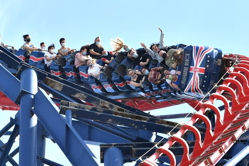 BLACKPOOL, ENGLAND - JULY 31: People ride on the Big One rollercoaster at Blackpool Pleasure Beach on July 31, 2020 in Blackpool, England. High temperatures are forecast across the UK today, with some areas in the south expected to reach 33-34C. (Photo by Anthony Devlin/Getty Images)