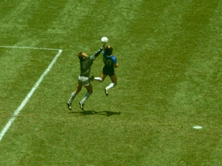 <p>Maradona scores the 'Hand of God' goal in 1986</p>Getty