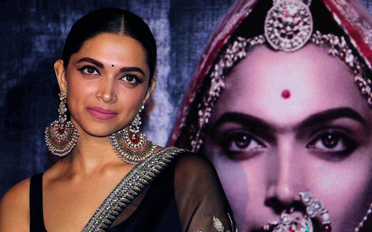 """A top Bollywood actress has been given a special police security detail amid ongoing protests over a historical drama. Deepika Padukone has received violent threats over her lead role in the film Padmavati - the fable of a 14th century Hindu queen of Rajasthan, based on an epic medieval poem.  Cinemas have been vandalised in response,and riot police put on alert for its release on December 1. Rightwing Hindu groups claim the film besmirches the name of Padmavati by insinuating she had a romance with a Muslim emperor while she was married to a Hindu king - a charge denied by the film's director. Demonstrators protest the release of the film in Bangalore Credit: REUTERS/Abhishek N. Chinnappa Mahipal Singh Akrana, president of fringe group Shree Rajput Karni Sena, said: """"Rajputs never raise a hand to women but if need be, we will do to Deepika what Lakshman did to Shurpanakha,"""" referring to a story from the Ramayana Hindu legend in which a demon princess has her nose chopped off as punishment. The director, Sanjay Leela Bhansali, has written to India's Central Board of Film Certification asking it to speed up the release and hold a pre-screening to clear up any confusion. He also released a video saying there was no objectionable scene between Padmavati and Alauddin Khilji, the Sultan of Delhi. The film has been beset with controversy since shooting began. Sets have beendestroyed, Mr Bhansali was attacked inJapiur, and a group puta £600,000bounty on the actress and director's heads. Security for Deepika Padukone has been beefed up Credit: STR/AFP/Getty Images The threats prompted Mumbai police to increase security for the director and Ms Padukone. """"We are providing her adequate security after the threat. The police will provide security at her residence as well as her office"""", Joint Commissioner of Police Deven Bharti told the Press Trust of India. Ms Padukone responded to the outcry, saying: """"Where have we reached as a nation? We have regressed. The only people we are"""