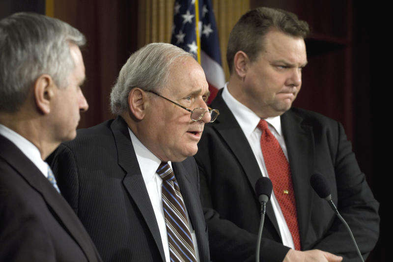 Senate Armed Services Committee Chairman Sen. Carl Levin, D-Mich., center, accompanied by committee member Sen. Jack Reed, D-R.I., left, and Sen. Jon Tester, D-Mont., speaks to reporters on Capitol Hill in Washington, Tuesday, Jan. 25, 2011, about their recent trip to Afghanistan. (AP Photo/Harry Hamburg)