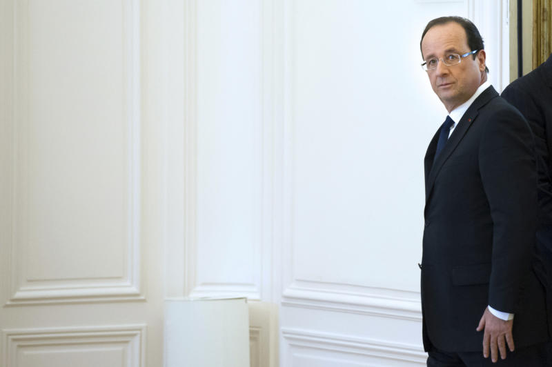 France's President Francois Hollande leaves a meeting at the OECD headquarters in Paris, Monday Oct. 29, 2012. (AP Photo/Bertrand Langlois, Pool)