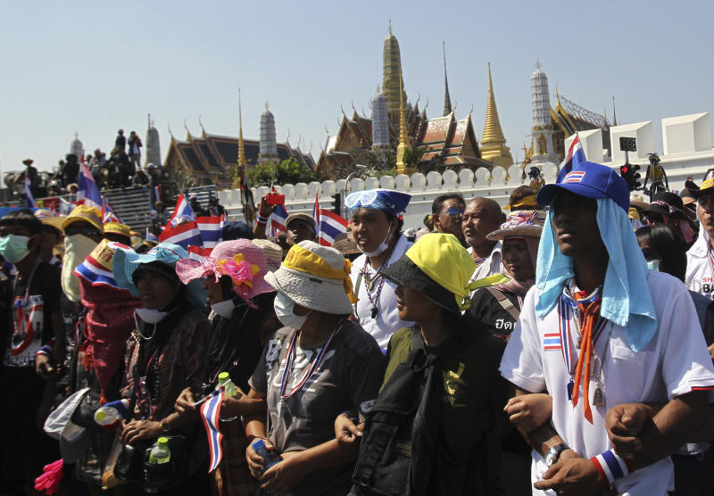Anti-government protesters take part in a rally in front of Grand Palace Wednesday, Jan. 15, 2014, in Bangkok, Thailand. Gunshots rang out in the heart of Thailand's capital overnight in an apparent attack on anti-government protesters early Wednesday that wounded at least two people and ratcheted up tensions in Thailand's deepening political crisis.(AP Photo/Sakchai Lalit)