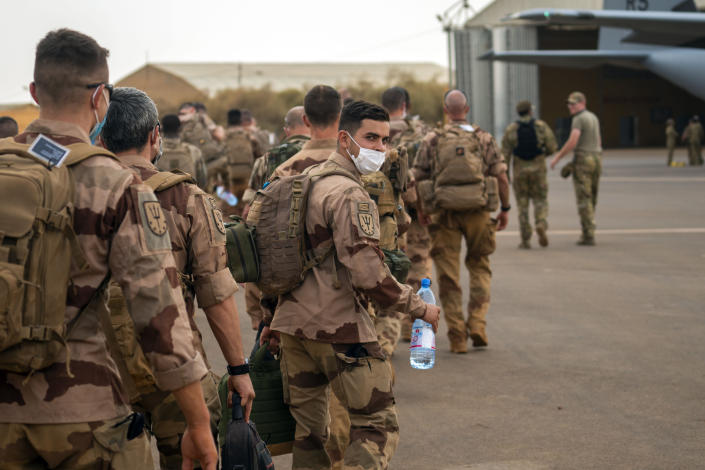 French Barkhane force soldiers who wrapped up a four-month tour of duty in the Sahel board a US Air Force C130 transport plane, leave their base in Gao, Mali Wednesday June 9, 2021. France has suspended joint military operations with Malian forces until the junta led by Col. Assimi Goita, who retook control of Mali's transitional government May 24, complies with international demands to restore civilian rule. (AP Photo/Jerome Delay)