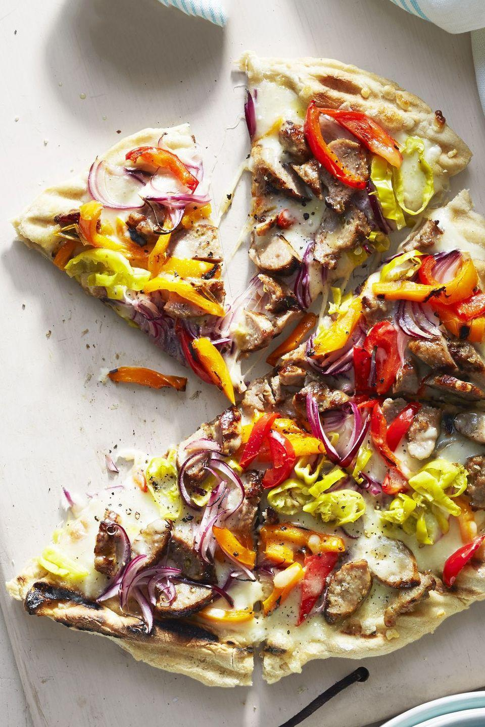 """<p>Use frozen pizza dough to easy make a savory and sharable app for pizza lovers.</p><p><a href=""""https://www.goodhousekeeping.com/food-recipes/easy/a45190/bbq-italian-sausage-pepper-pie-recipe/"""" rel=""""nofollow noopener"""" target=""""_blank"""" data-ylk=""""slk:Get the recipe for BBQ Italian Sausage and Pepper Pie»"""" class=""""link rapid-noclick-resp""""><em>Get the recipe for BBQ Italian Sausage and Pepper Pie»</em></a></p>"""