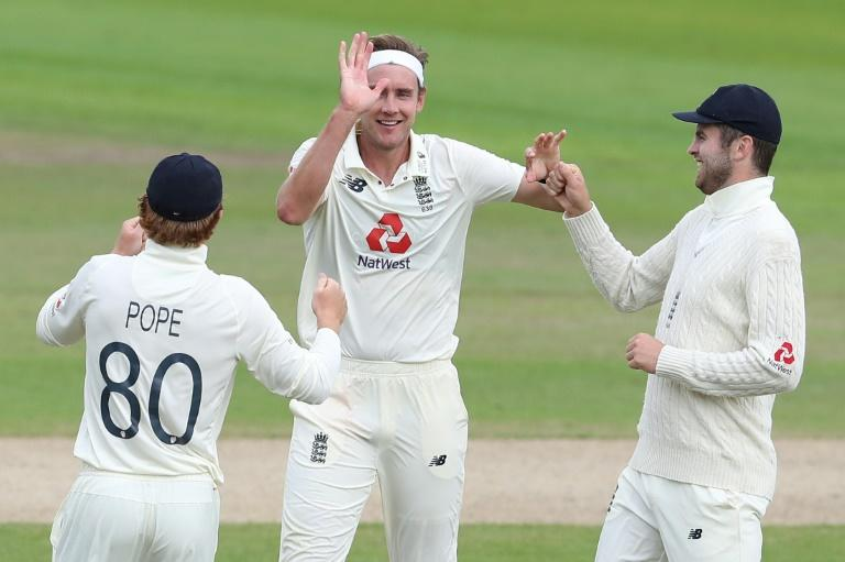 Man of the moment: Stuart Broad celebrates with teammates after taking the wicket of Roston Chase