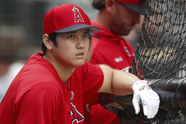 Los Angeles Angels' Shohei Ohtani looks on during batting practice before the start of a baseball game against the Chicago White Sox Saturday, Sept. 7, 2019, in Chicago. (AP Photo/Jim Young)