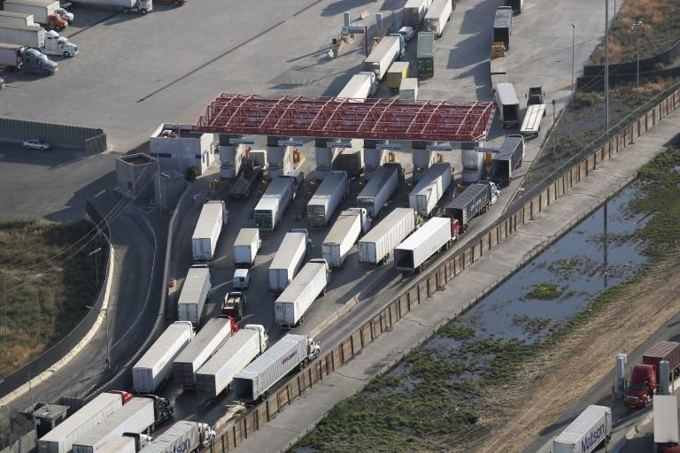 Freight trucks, as seen from a helicopter, pass through Mexican Customs before entering the United States, at the Otay Mesa port of entry near San Diego, California