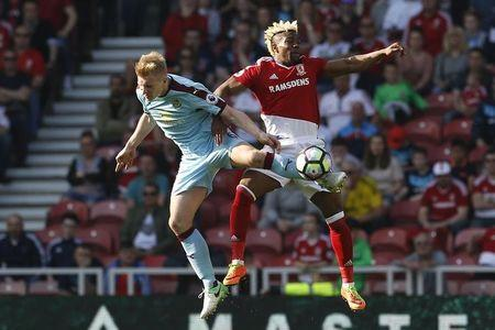 Britain Football Soccer - Middlesbrough v Burnley - Premier League - The Riverside Stadium - 8/4/17 Burnley's Ben Mee in action with Middlesbrough's Adama Traore  Action Images via Reuters / Craig Brough Livepic