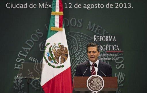 Mexican President Enrique Pena Nieto delivers a speech before signing a constitutional reform bill that allows state-owned oil company Pemex to partner with private firms for oil exploration and extraction in Mexico City, on August 12, 2013