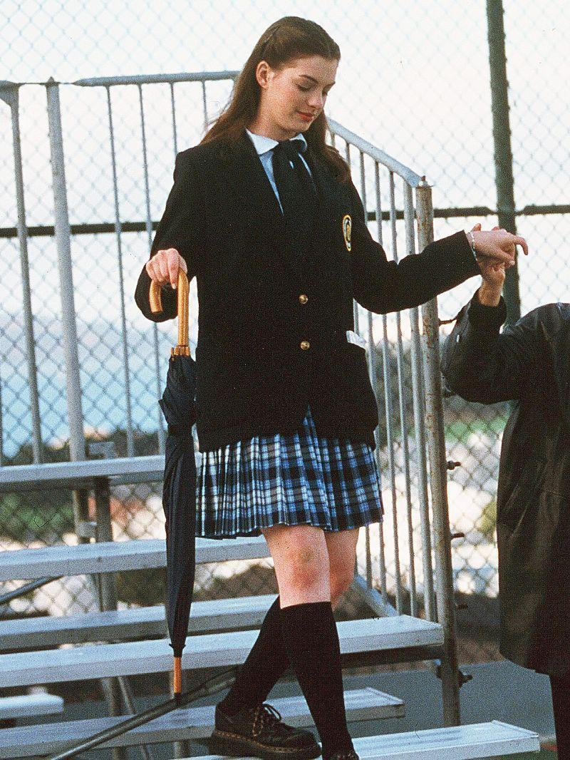 <p>Mia changed a lot about herself to take over the crown, but the one thing she couldn't change was her school uniform. Enter: Her beloved Dr. Martens. </p>