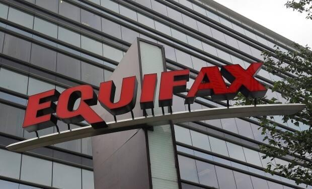 Equifax is one of two main agencies that compile credit scores on Canadians.   Missing bill payments, or maxing out credit cards, can lead to a low score that insurance companies believe hints at risky driving.   (Mike Stewart/The Associated Press - image credit)