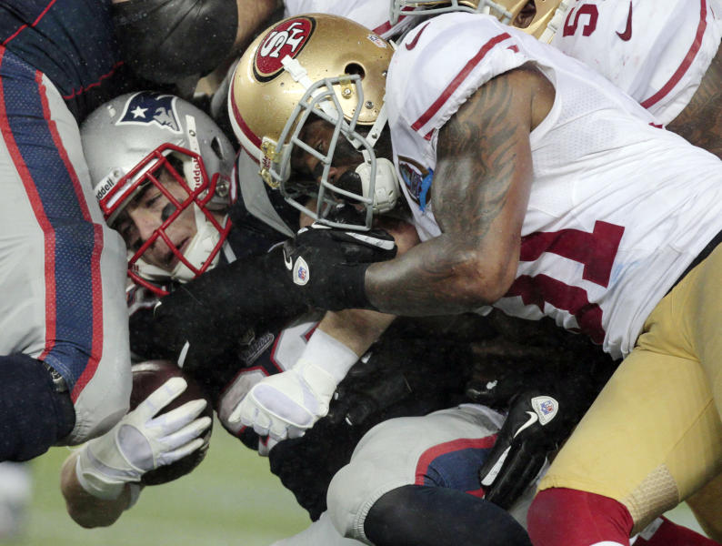 San Francisco 49ers strong safety Donte Whitner (31) tackles New England Patriots running back Danny Woodhead (39) in the third quarter of an NFL football game in Foxborough, Mass., Sunday, Dec. 16, 2012. (AP Photo/Steven Senne)