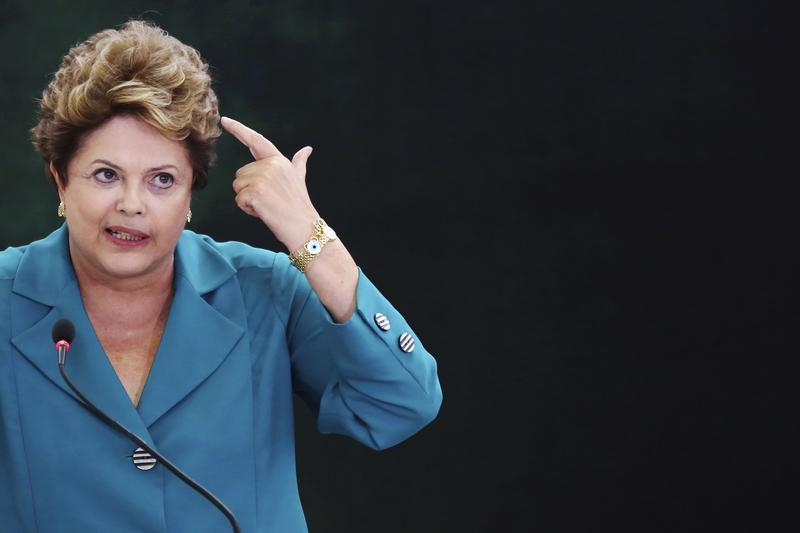 Brazil's President Rousseff speaks during a ceremony where she signs into law, the bill that allocates the country's oil royalties to education and health care, in Brasilia