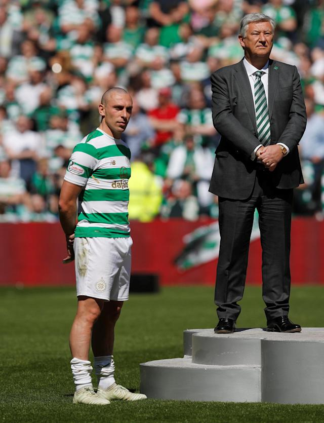Soccer Football - Scottish Premiership - Celtic vs Aberdeen - Celtic Park, Glasgow, Britain - May 13, 2018 Celtic's Scott Brown and Celtic chief executive Peter Lawwell before the trophy presentation after the match REUTERS/Russell Cheyne