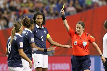 MONTREAL, QC - JUNE 26: Referee Carol Anne Chenard signals a yellow card to Laura Georges #4 of France during the FIFA Women's World Cup Canada 2015 quarter final match between Germany and France at Olympic Stadium on June 26, 2015 in Montreal, Canada.  (Photo by Francois Laplante/FreestylePhoto/Getty Images)