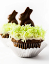 """<p>Underneath that coconut grass is a delicious and moist hummingbird cupcake.</p><p><em><a href=""""http://hapanom.com/easter-cupcakes/"""" rel=""""nofollow noopener"""" target=""""_blank"""" data-ylk=""""slk:Get the recipe from Hapa Nom Nom »"""" class=""""link rapid-noclick-resp"""">Get the recipe from Hapa Nom Nom »</a></em><br></p>"""