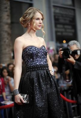 "Singer Taylor Swift attends the premiere of ""Hannah Montana the Movie"" in Los Angeles April 2, 2009."