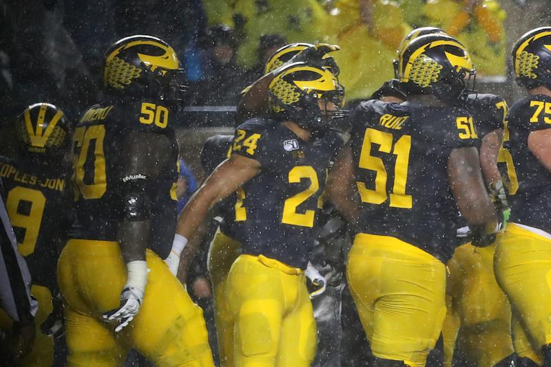 ANN ARBOR, MICHIGAN - OCTOBER 26: Zach Charbonnet #24 of the Michigan Wolverines celebrates a first half touchdown with teammates while playing the Notre Dame Fighting Irish at Michigan Stadium on October 26, 2019 in Ann Arbor, Michigan. (Photo by Gregory Shamus/Getty Images)