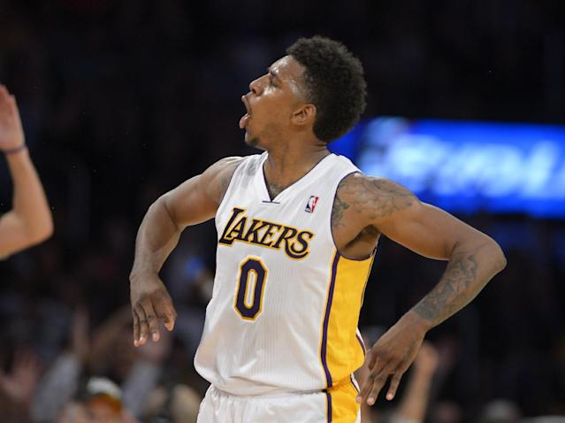 Los Angeles Lakers forward Nick Young celebrates after hitting a three point shot during the second half of an NBA basketball game against the Orlando Magic, Sunday, March 23, 2014, in Los Angeles. The Lakers won 103-94. (AP Photo/Mark J. Terrill)