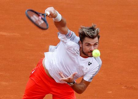FILE PHOTO: Tennis - ATP 1000 - Monte Carlo Masters - Monte-Carlo Country Club, Roquebrune-Cap-Martin, France - April 16, 2019 Switzerland's Stan Wawrinka in action during his second round match against Italy's Marco Cecchinato REUTERS/Eric Gaillard