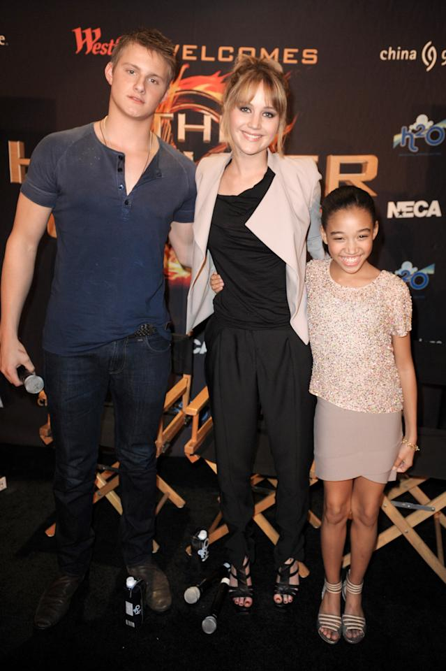 PLANTATION, FL - MARCH 08:  Alexander Ludwig, Jennifer Lawrence and Amandla Stenberg visit the Broward Mall on March 8, 2012 in Plantation, Florida.  (Photo by Gustavo Caballero/Getty Images for Allied-THA)