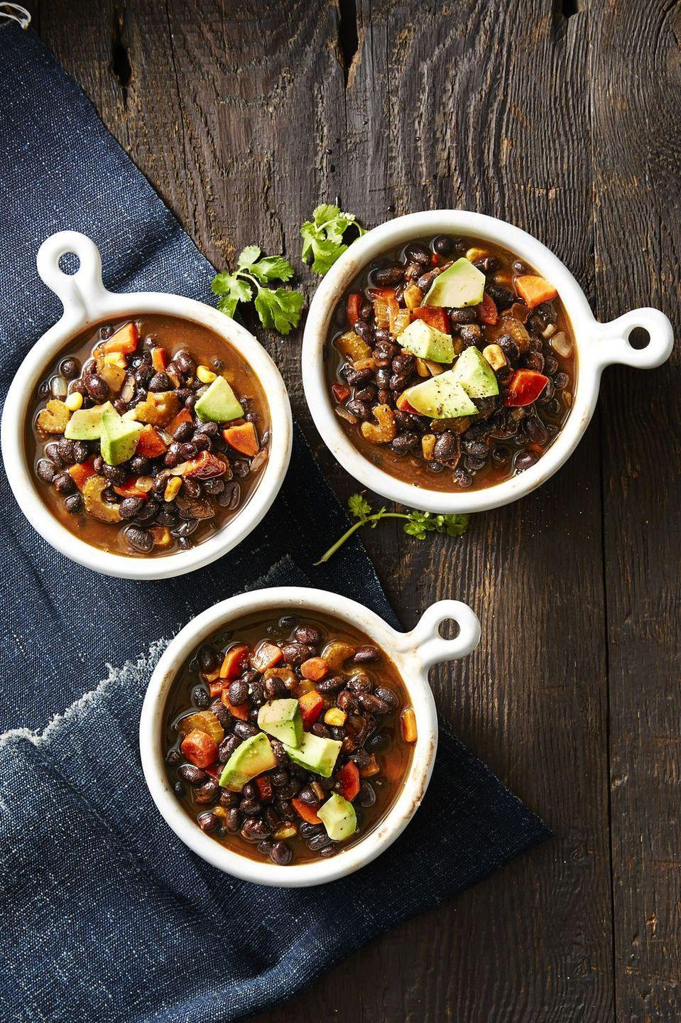 """<p>Vegetables are the true star of this hearty, <a href=""""https://www.goodhousekeeping.com/food-recipes/easy/g27927452/fall-soups/"""" rel=""""nofollow noopener"""" target=""""_blank"""" data-ylk=""""slk:healthy soup recipe"""" class=""""link rapid-noclick-resp"""">healthy soup recipe</a>, making it a perfect option for your vegan friends.</p><p><em><a href=""""https://www.goodhousekeeping.com/food-recipes/healthy/a42397/smoky-vegan-black-bean-soup-recipe/"""" rel=""""nofollow noopener"""" target=""""_blank"""" data-ylk=""""slk:Get the recipe for Vegan Black Bean Soup »"""" class=""""link rapid-noclick-resp"""">Get the recipe for Vegan Black Bean Soup »</a></em></p>"""