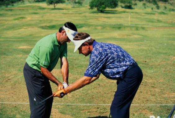Seve Ballesteros and Nick Price on the range in Sun City in 1997