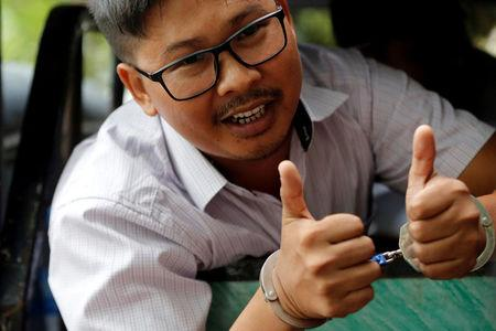 FILE PHOTO: Detained Reuters journalist Wa Lone gestures as he leaves after a court hearing in Yangon, Myanmar June 5, 2018.     REUTERS/Ann Wang/File Photo