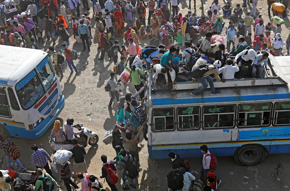 Migrant workers travel on crowded buses as they return to their villages, during a 21-day nationwide lockdown to limit the spreading of coronavirus disease (COVID-19), in Ghaziabad, on the outskirts of New Delhi, India, March 29, 2020. REUTERS/Adnan Abidi