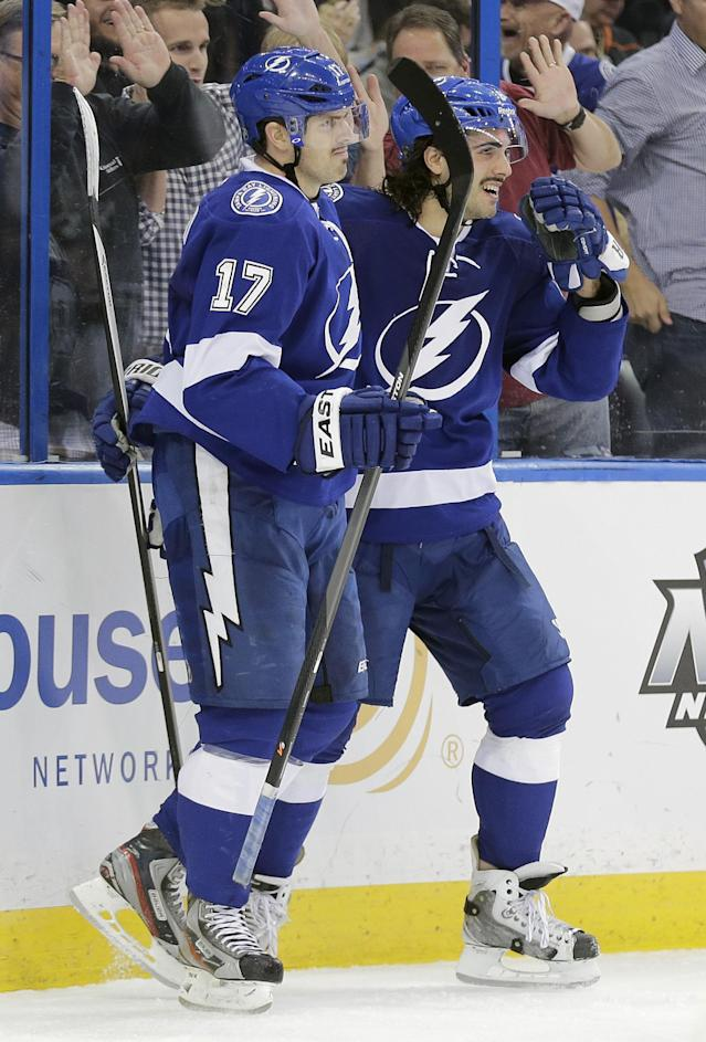 Tampa Bay Lightning center Alex Killorn (17) celebrates with teammate defenseman Mark Barberio after scoring a goal against the Anaheim Ducks during the second period of an NHL hockey game on Thursday, Nov. 14, 2013, in Tampa, Fla. (AP Photo/Chris O'Meara)